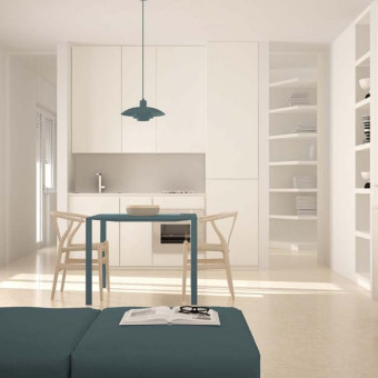 Open space with kitchen, very light yellow Ultratop Loft, white base